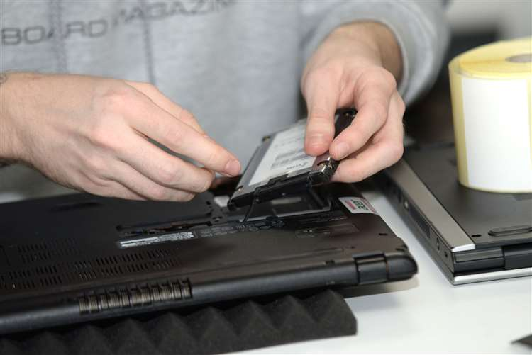 ITVET team member installing a new Solid State Drive