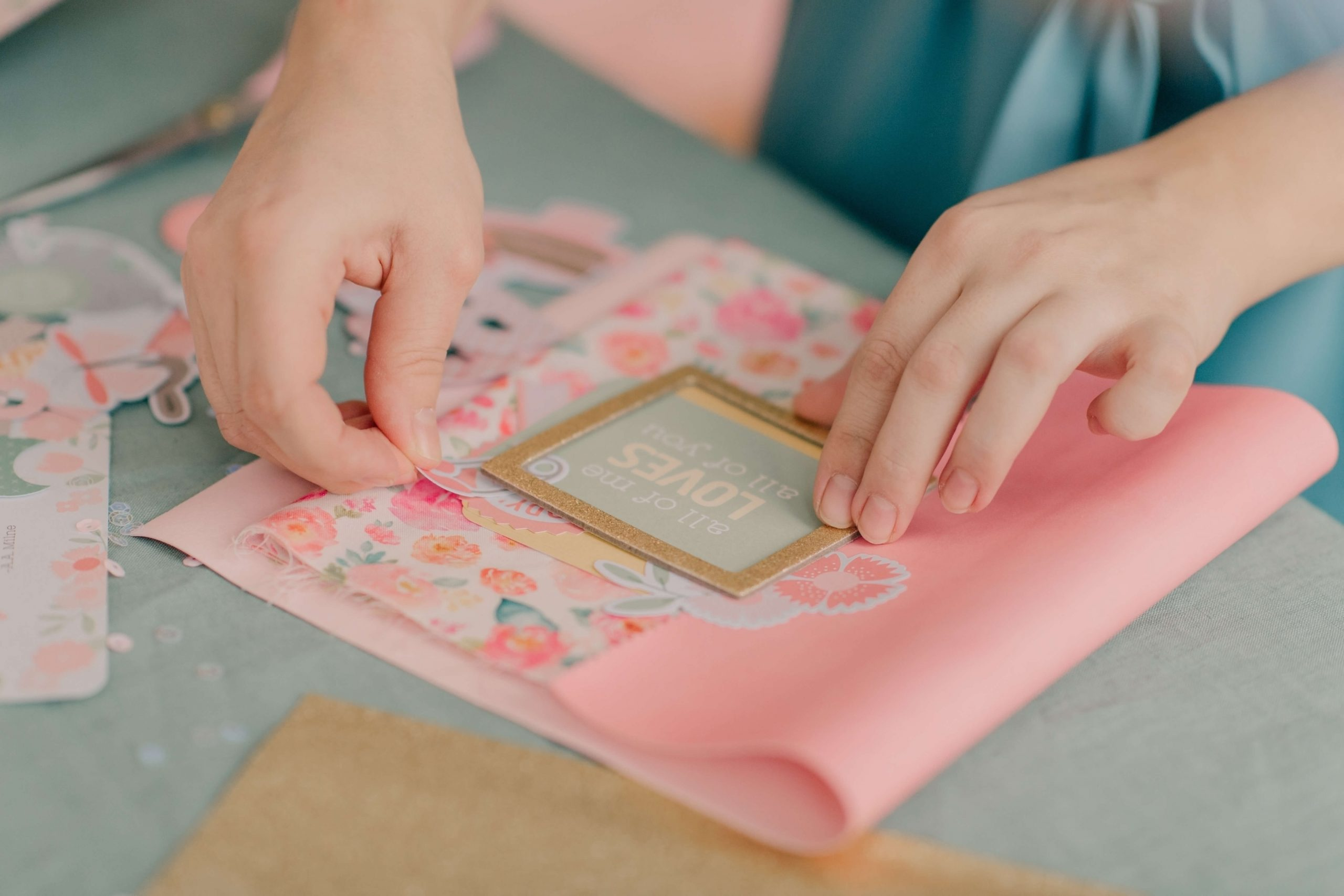 A person making a homemade card for Cards for Bravery